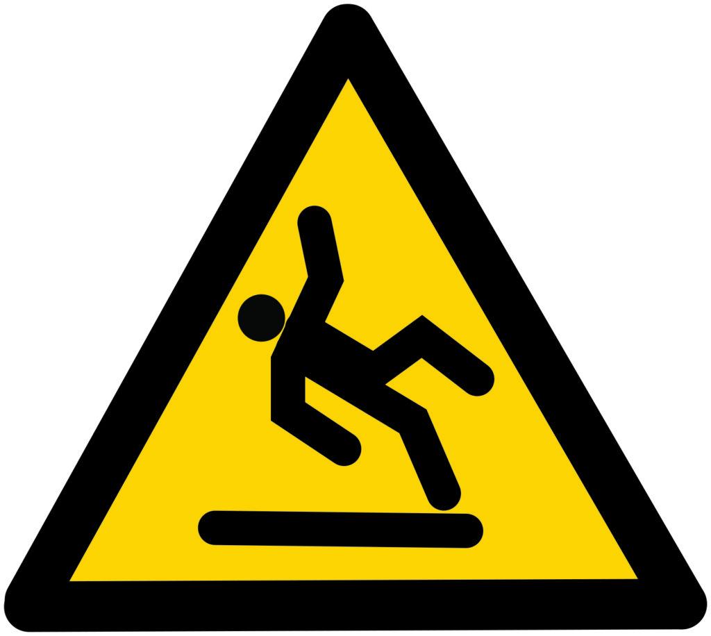 Yellow and black warning signage: Slippery