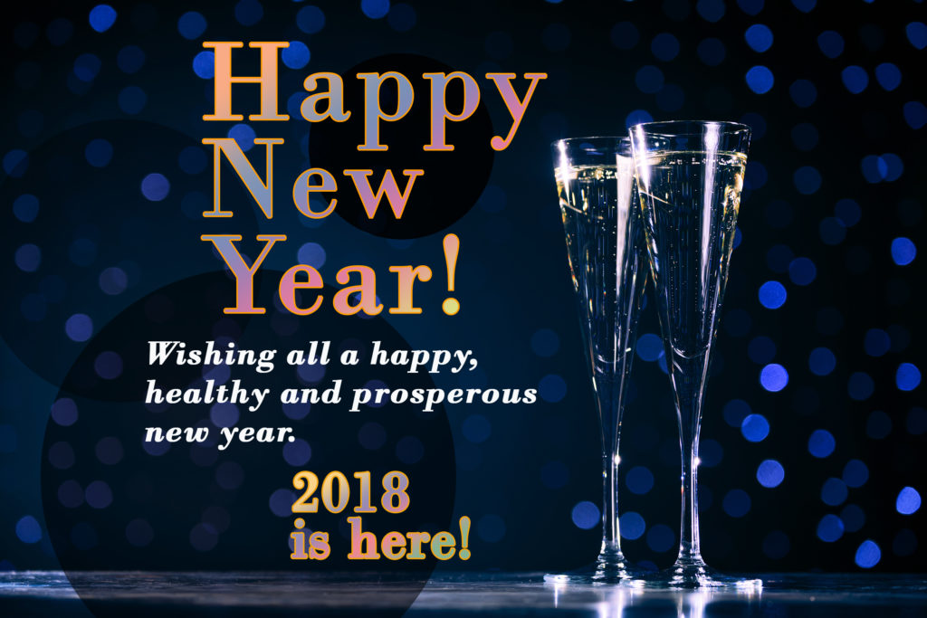 Two champagne glass on dark indigo background with colorful lettering Happy New Year!