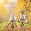 Happy Seniors Riding Bicycles in the Autumn Woods.