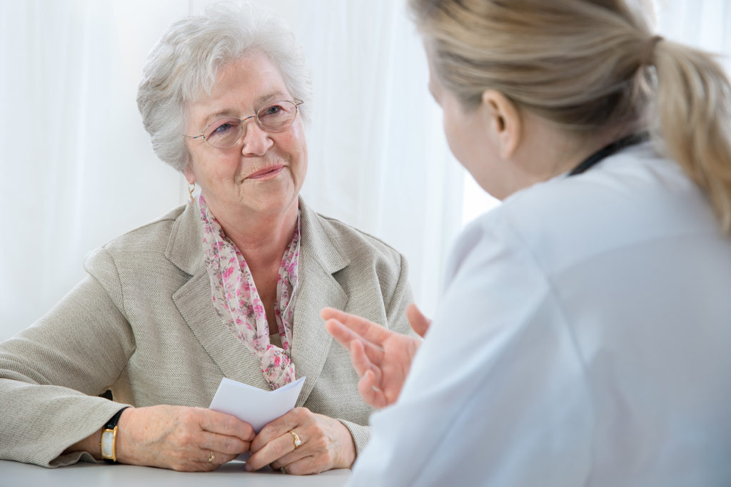 Nurse discussing care plan with patient.
