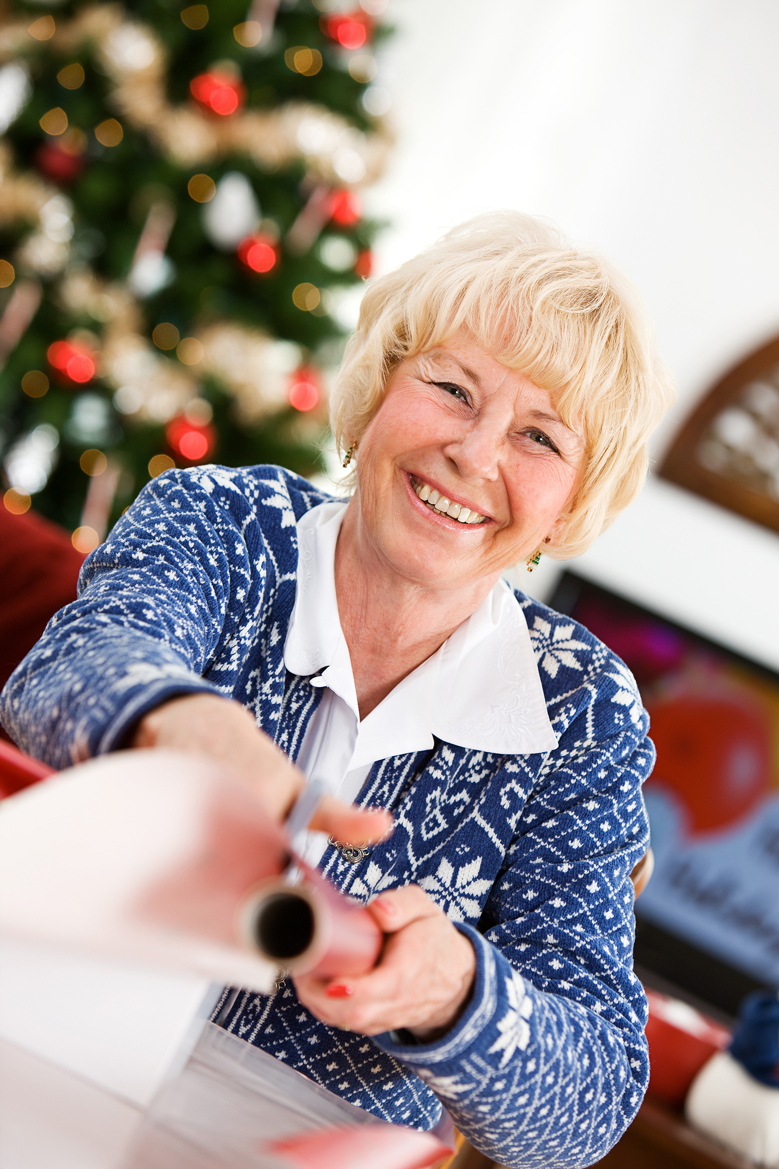 Christmas: Senior Woman Wrapping Gifts