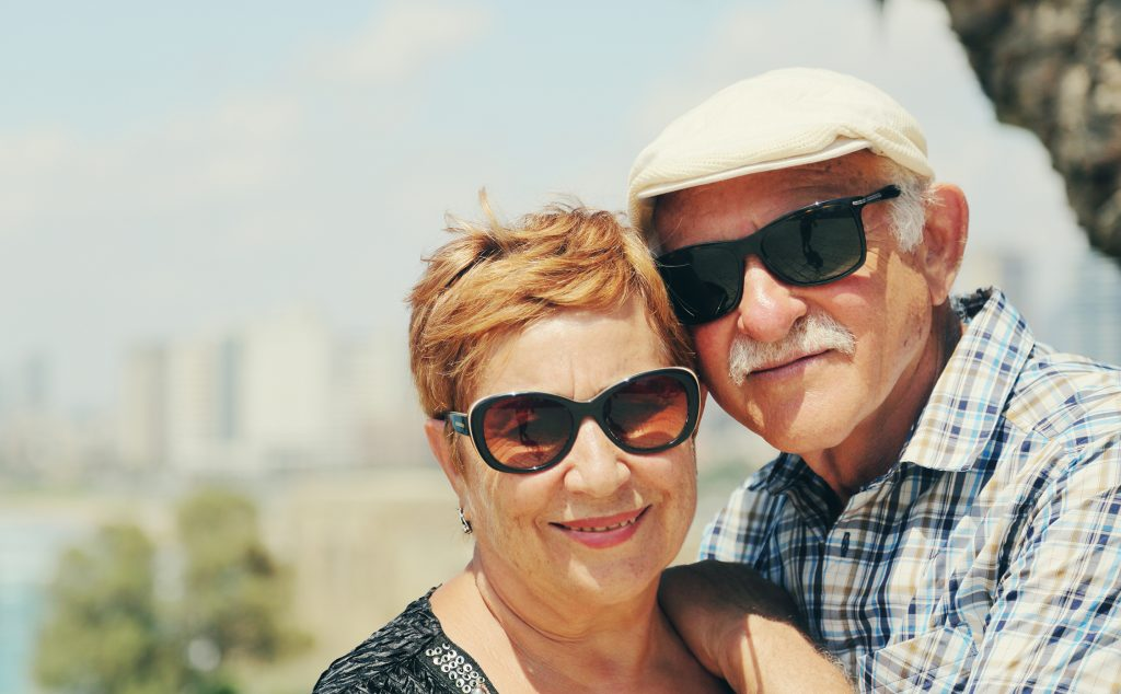 Senior couple with sunglasses outdoors