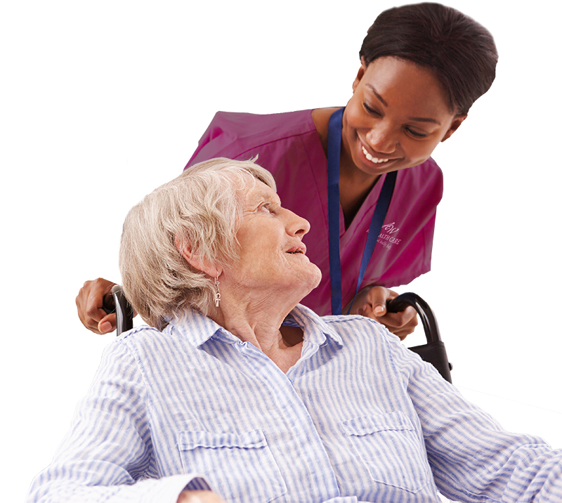 Nurse smiling with patient in wheelchair.